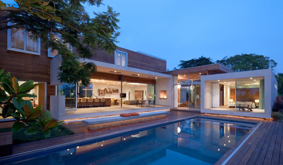 Fachada casa moderna dos pisos con piscina