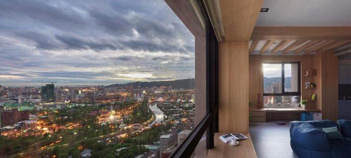 Sala moderna con vista a la ciudad