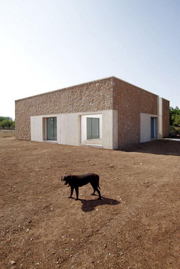 Diseño de casa de campo fachada barro y piedra