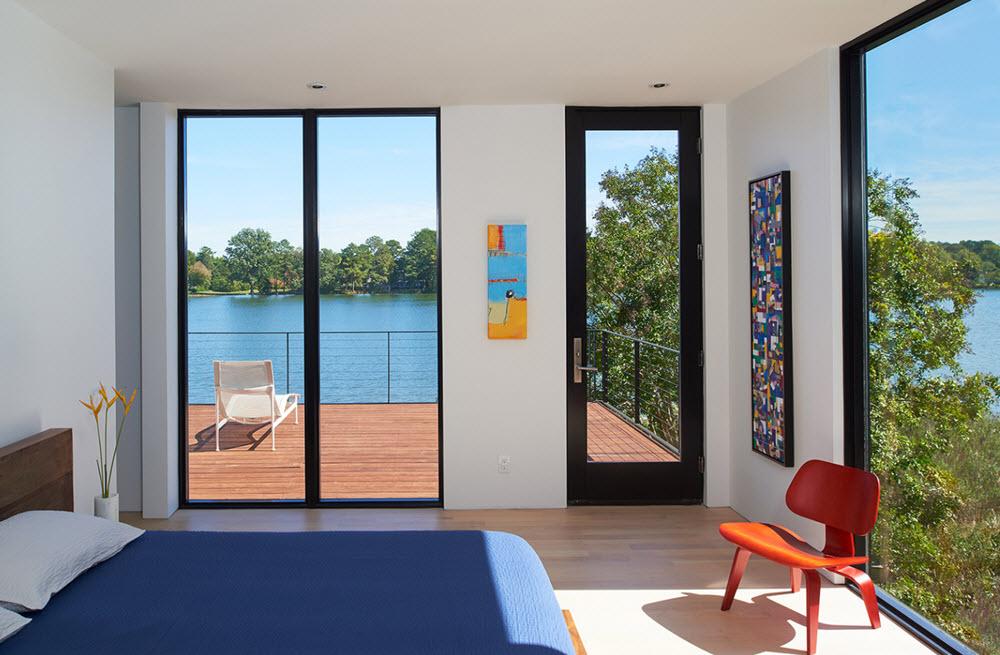 Diseño de dormitorio con vanos enmarcado el paisaje