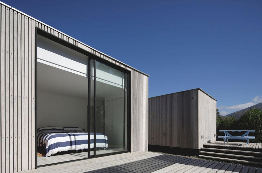 Diseño de dormitorio con amplias mamparas