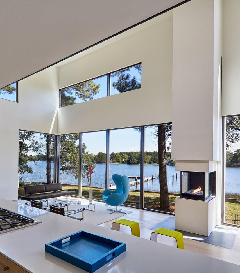Diseño sala con ventanas en L para tener una amplia vista panorámica del exterior