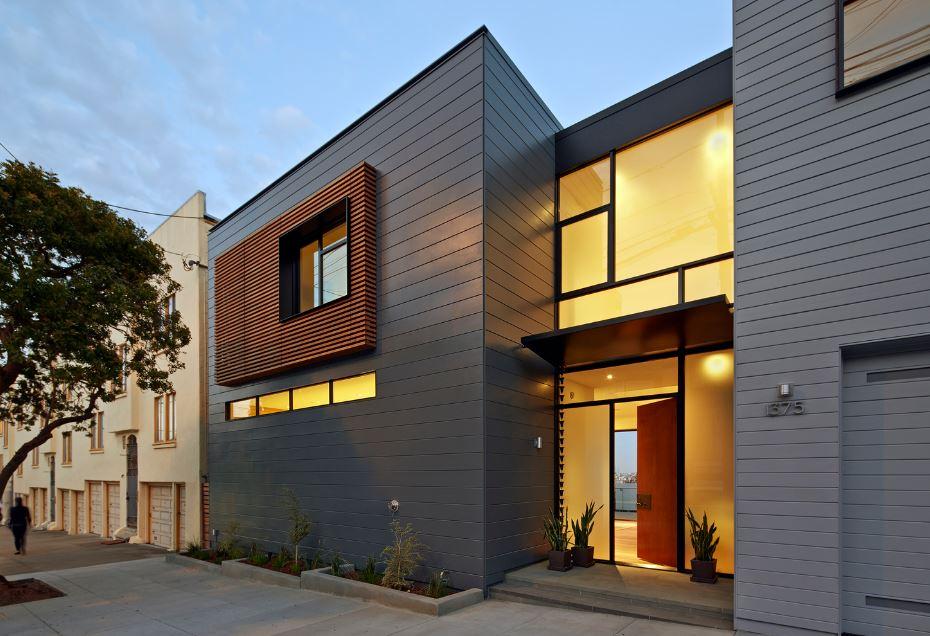 Dise o de moderna casa construida en terreno en desnivel for Detalles para casas modernas
