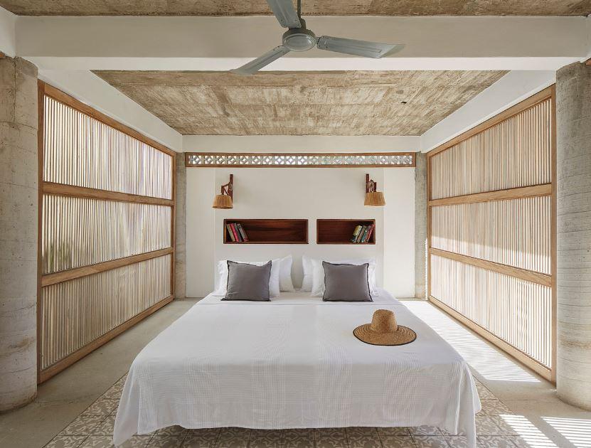 Hermosos interiores en concreto expuesto y madera