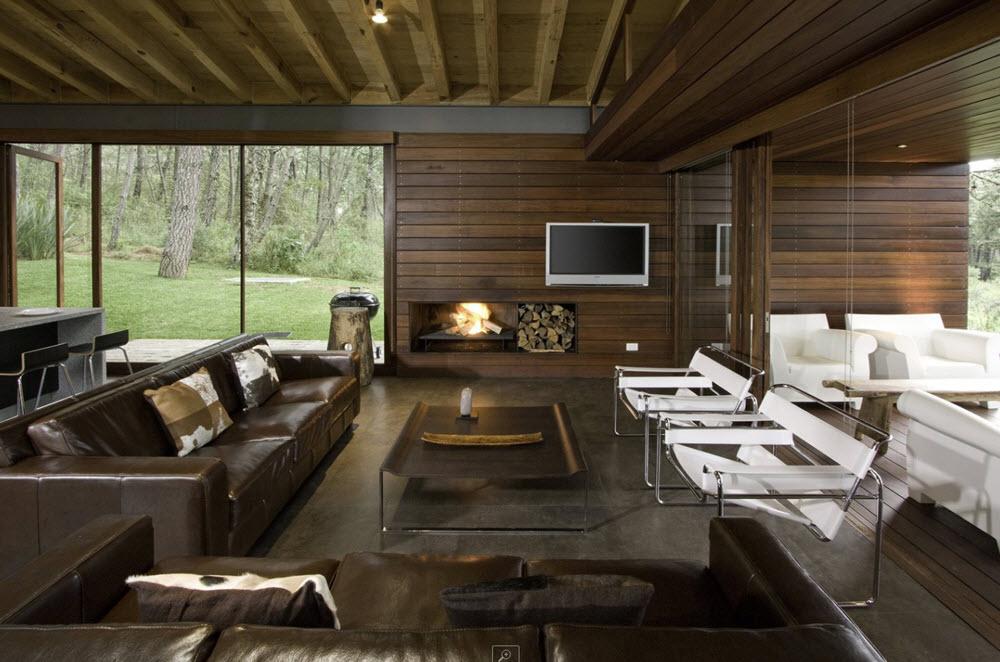 Moderna sala con paredes en madera planos de arquitectura for Salas de madera modernas