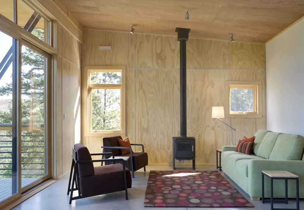 Moderna sala en madera de cabaña