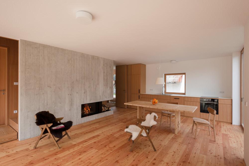 Diseño de cocina comedor con madera en pisos y muebles
