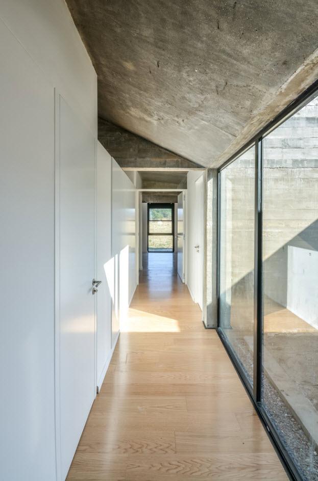 Casa de un piso construida en concreto planos de for Diseno pasillos interiores
