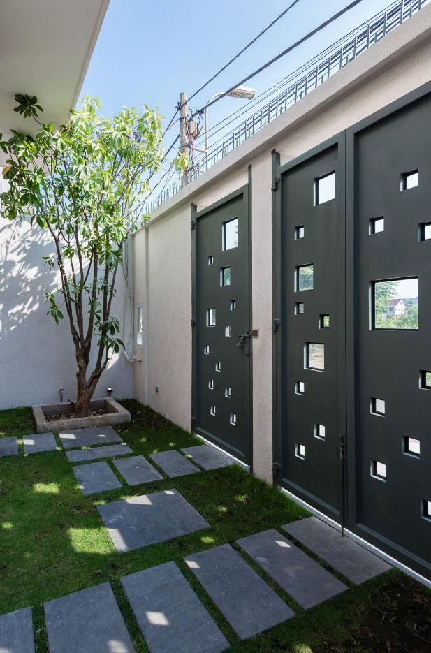 Dise o de casa moderna 112 m planos de arquitectura for Puertas de metal con diseno