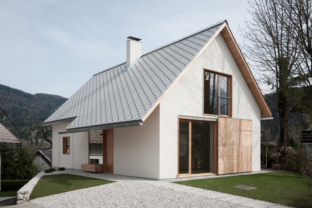 Peque a casa con techos a dos aguas planos de arquitectura - Tipos de tejados para casas ...
