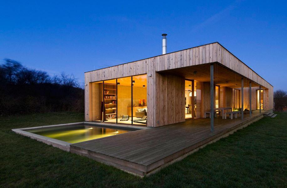 Casa de un piso y dos dormitorios presenta modernos exteriores e interiores de madera planos Interiores de casas modernas de un piso
