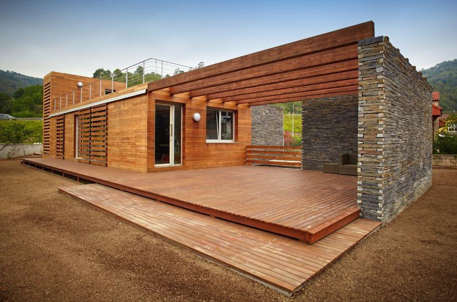 Moderna casa de dos pisos presenta dise o sustentable con - Casas de piedra y madera ...