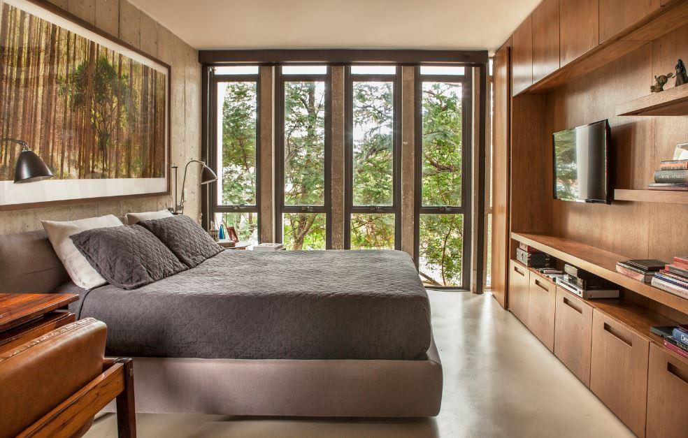 Moderno dormitorio con aplicaciones de madera