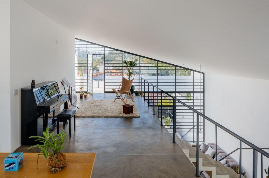 Dise o de moderna casa de dos pisos y dos dormitorios for Diseno escaleras para segundo piso