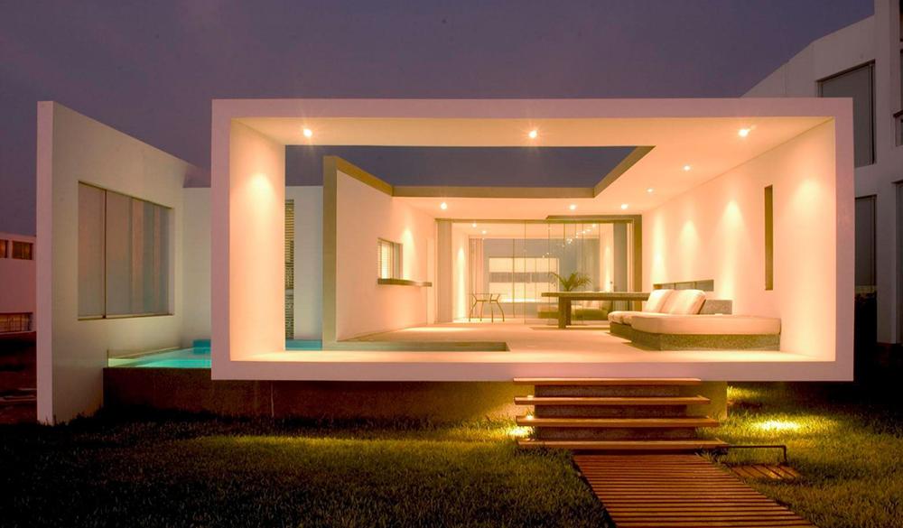 Dise o de moderna casa de playa amplios interiores for Diseno de interiores de casas planos