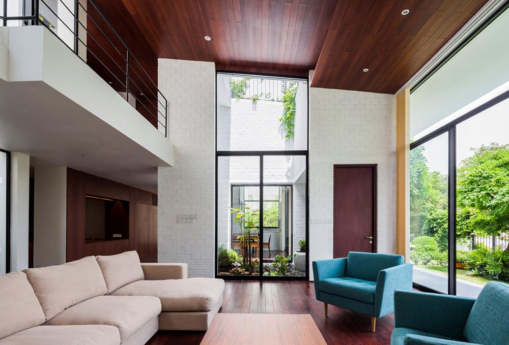 Planos de casa moderna de dos pisos con techo verde estructura de ladrillo y techo escalonado for Diseno de interiores de casas de dos plantas